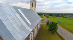 Old catholic church building. Nature landscape. Close up flight. Aerial footage. - stock footage