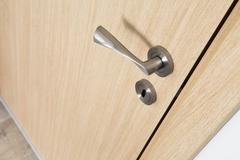 Modern light wood interior wooden door detail Stock Photos