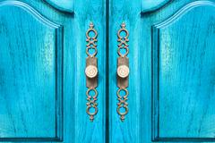 Stylish brass door handles on a cabinet or closet Stock Photos