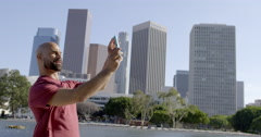 Mixed race man blows kisses to phone in Downtown LA 4K Stock Footage