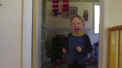 Camera tracking in front, kid jumps into arms of mom Stock Footage
