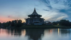 Time lapse of sunrise at Sarawak river, with a view of Sarawak State Legislative Stock Footage