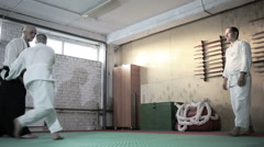 Athletes in a kimono demonstrating martial arts techniques. martial arts Stock Footage