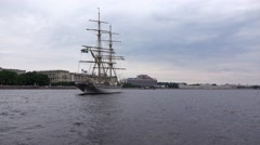 Tre Kronor brig standing still on Neva river waters, view from boat in motion - stock footage