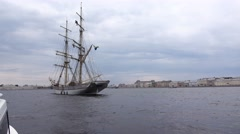 Approach elegant sailing ship, anchored at Neva river, tilt up to masts Stock Footage
