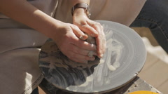 Woman tries to learn craftsmanship pottery to create clay articles Stock Footage