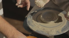 Woman tries to learn art of pottery for first time in her life Stock Footage