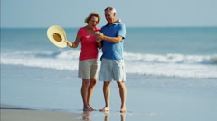 Mature Caucasian couple taking selfie on smartphone on the beach Stock Footage