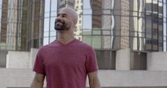 Mixed race man looking at views while visiting big city 4K Stock Footage