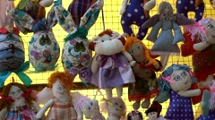 Zoom out handmade stuffed toys collection for sale Stock Footage