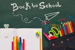 School supplies on blackboard with infographics Kuvituskuvat