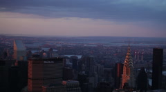 MetLife Building and Chrysler Building in New York City at dusk Stock Footage