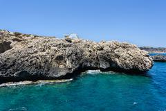Pirate bay in protaras paralimni, white church, blue sea and rocks - stock photo