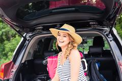 Young woman with suitcases. Vacation concept. Car trip. Summer travel Kuvituskuvat