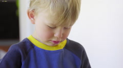 Funny boy plays dress up - stock footage