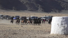 BUZKASHI BUSHKASHI BUSKASHI KOKPAR KUPKARI FESTIVAL HORSEMAN Stock Footage