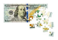 Money puzzle - stock photo
