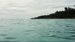 Handheld shot of swimming on the edge of Indian Ocean Stock Footage
