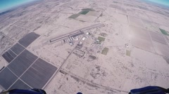 Skydiver parachuting above Arizona. Flight. Sunny day. Extreme sport. Sand - stock footage
