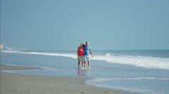 Happy senior Caucasian couple having fun on their beach holiday Stock Footage