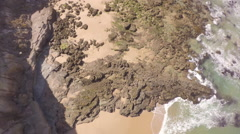 Aerial top view of white water waves crashing on rocks - Portugal Stock Footage