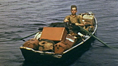 USA 1944: man rowing a fishermen boat Stock Footage