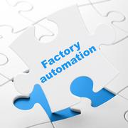Manufacuring concept: Factory Automation on puzzle background Piirros