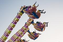 Hanging funfair attraction - stock photo