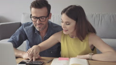 Attracitve young couple counting home finances Stock Footage