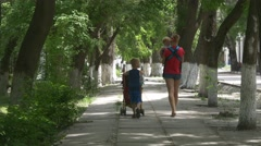 Mother walking with children Stock Footage