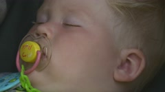 Kid is sleeping and sucking a pacifier Stock Footage