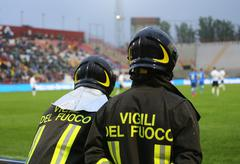 Italian firefighters with uniform with the inscription FIREFIGHTERS  in the S - stock photo