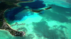 Aerial of Overwater Bungalows Matira Point Bora Bora South Pacific ocean Stock Footage