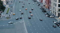 Cars are moving down the street Stock Footage