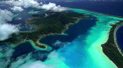 Aerial of Bora Bora reef lagoon a tropical Resort Island South Pacific Stock Footage