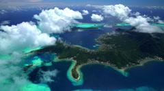 Aerial of Bora Bora Mt Otemanu Vaitape tropical Overwater Bungalows Stock Footage