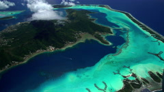 Aerial of Bora Bora Island paradise vacation resort South Pacific Stock Footage