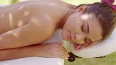 Woman looking over in outdoor beauty spa Stock Footage