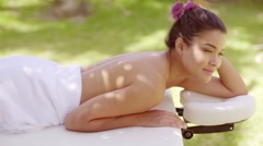 Woman looking over in outdoor beauty spa - stock footage