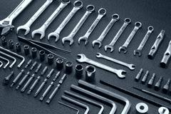 Hardware hand tools kit for mechanics laid out in order isolated Stock Photos