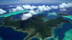 Aerial view of Bora Bora Mt Otemanu Overwater Bungalows South Pacific Stock Footage