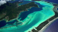 Aerial view of Bora Bora Mt Otemanu Overwater Bungalows South Pacific Ocean Stock Footage