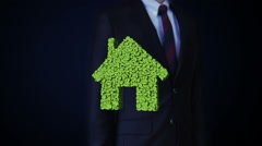 Businessman touching eco green house made from leaves.leafs. Stock Footage