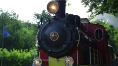 Close up of historic retro steam train in the forest Stock Footage