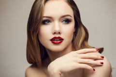 Classic red lips girl looking to right - stock photo
