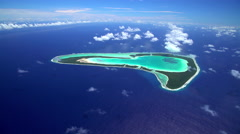 Aerial view of the coral atoll reef Tupai Heart Island South Pacific Ocean Stock Footage