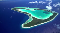 Aerial of Tupai Heart Island coral lagoon atoll French Polynesia South Pacific Stock Footage