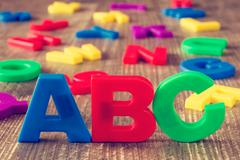 ABC spelling and pile of color letters Stock Photos
