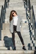Girl on stair Stock Photos