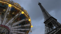 Vintage merry-go-round and Eiffel Tower Stock Footage